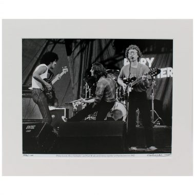Rory, Phil & Paul - photographic print of Rory Gallagher, Phil Lynott & Paul Brady playing in concert together at Punchestown in 1982, taken & signed by Hot Press Photographer Colm Henry