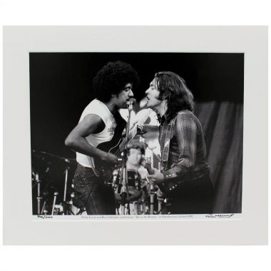 Rory & Phil mount photo, Rory Gallagher & Phil Lynott performing together at Punchestown 1982, photographic print taken and signed by Colm Henry