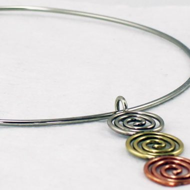 Beautiful All the Suns Necklet made from a mix of metals, copper, brass and alpaca silver, made in Ireland