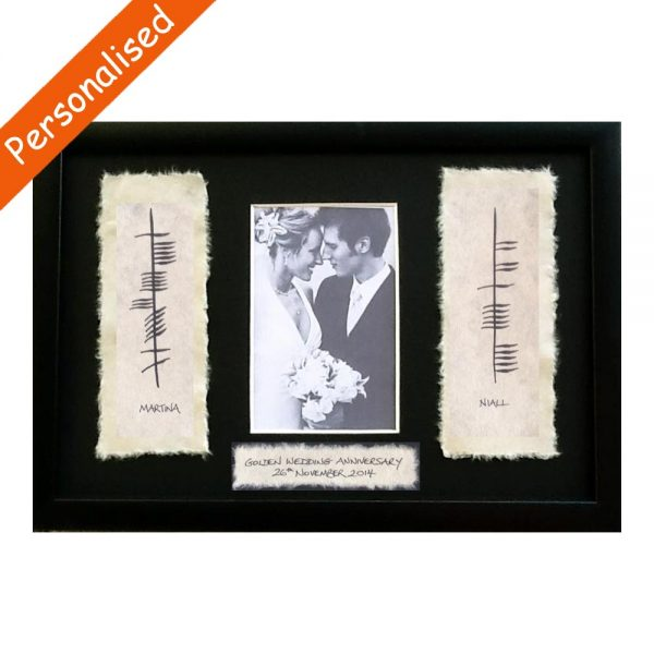 Ogham 50th Wedding Anniversary gift made in Ireland. Photo frame with couples' names written in Ogham on handmade paper in a slim black frame