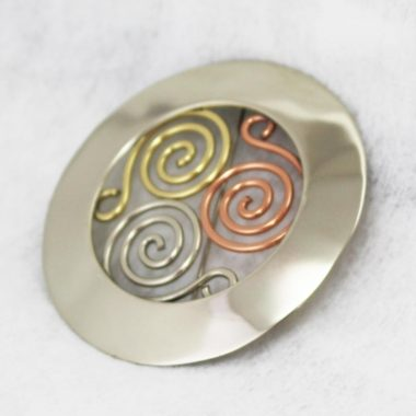 Triscle Brooch, made with a mix of metals, copper, brass & alpaca silver, made in Ireland